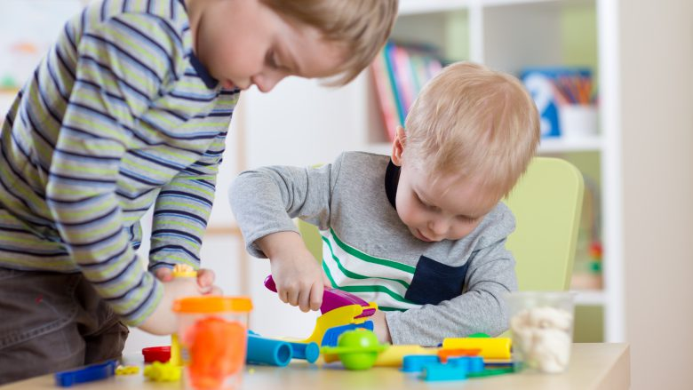 Kids Play Modeling Plasticine, Children Mold Colorful Clay Dough.  Preschooler Playing Together in Nursery