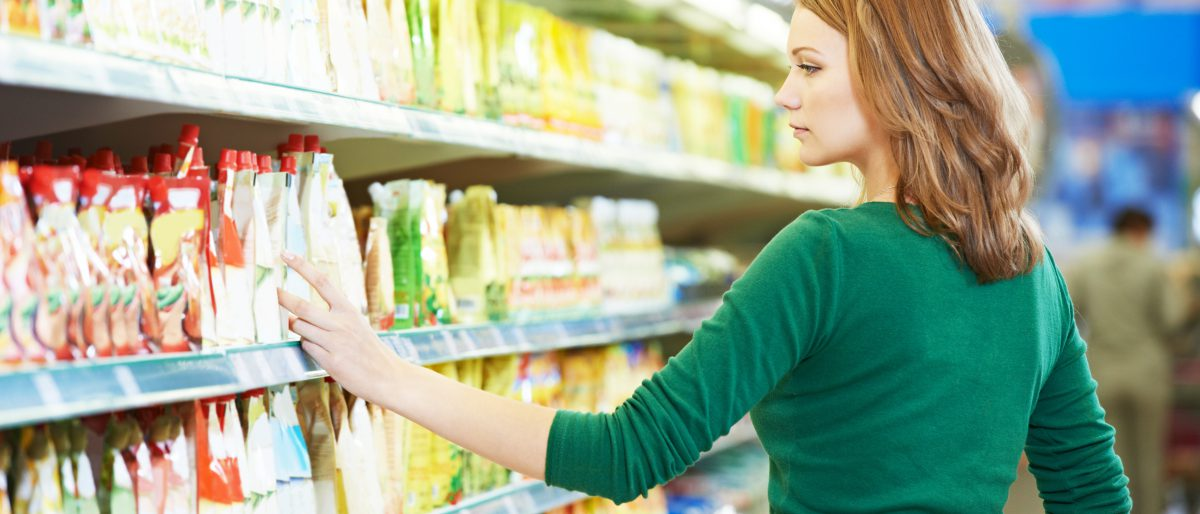 Shopping. Woman choosing bio food cheese products in dairy store or supermarket