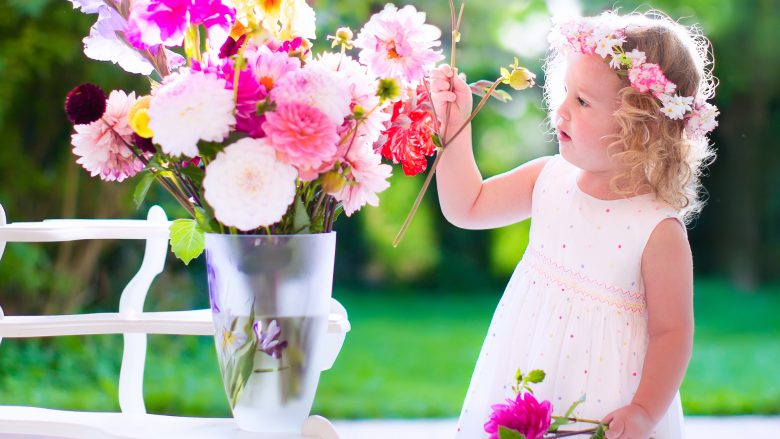 Little Girl Playing With Fresh Flowers